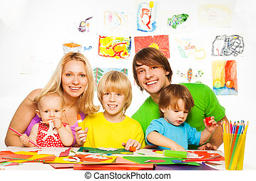 Fun way to parent your kids - Family of two parents and...