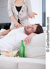 Husband sleeping instead of helping his wife