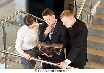 Business people at the office - Business people with laptop...