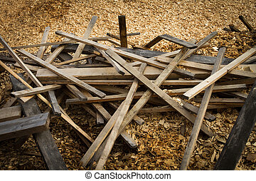 Old scrap lumber and wood chips - Pile of discarded lumber...