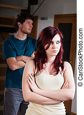 Separate lovers with problems - A man and a women standing...