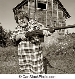 Angry woman with big gun - Shotgun Momma protects her...