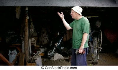 Mans emotion in garage - Man angry in village garage