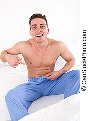 man with problem in bedroom - man in pajamas with problem in...