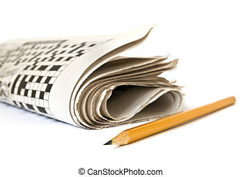 Crossword in newspaper - Crossword and pencil isolated on...