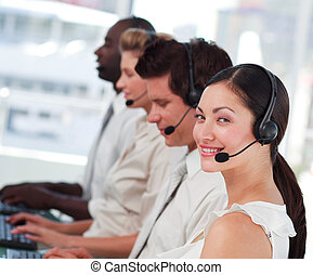 Attractive woman smiling on headset - Young Attractive...