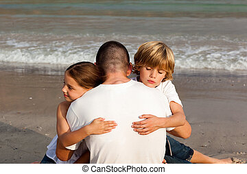 Children hugging their father - Potrait of Children hugging...