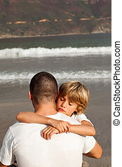 Young Boy Hugging his father - Portrait of a Young Boy...