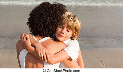 Young boy hugging his mother - Potrait of aYoung boy hugging...