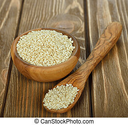 sesame seeds on a brown background