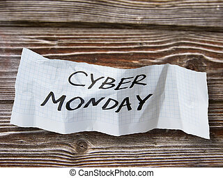 """word""""  cyber monday """"  on torn paper on wood background"""
