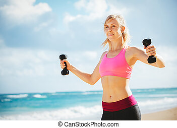 Beautiful athletic young woman exercising - Beautiful...