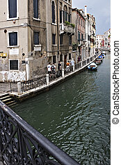 boats at a channel in Venice, Italy - boats and houses at a...