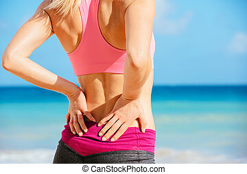 Back Pain Concept - Back Pain Athletic fitness woman rubbing...