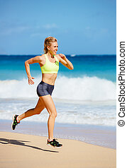 Athletic Young Woman Running on the Beach - Athletic Fitness...