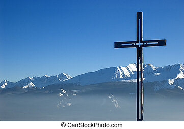 Cross on the top of a mountain - Cross in mountain scenery....