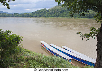 Boats - Three boats at the bank of the river, Laos