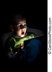Surprised boy - Boy wonder looking at the tablet