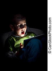 Surprised boy - Boy wonder looking at the tablet