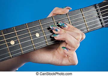 guitar fretboard on a blue background