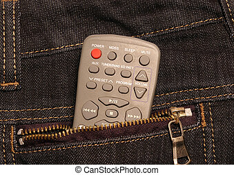 Remote control in a female\'s jeans pocket