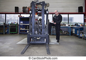 Forklift Quality Control - Mechanic going over the quality...