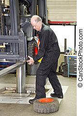Forklift Mechanic at work - Forklift mechanic replacing a...