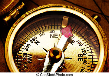 Compass - Close up view of the compass on old paper