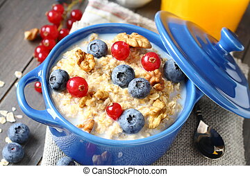 Healthy Tasty Homemade Oatmeal with Berries for Breakfast -...