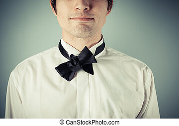 Young man with messy bow tie - Young man does not know how...