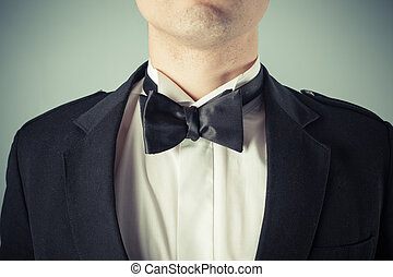 Young man wearing a bow tie and tuxedo
