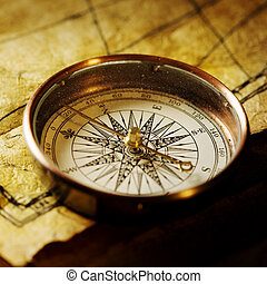 Compass - Close up view of the Compass on the old paper...