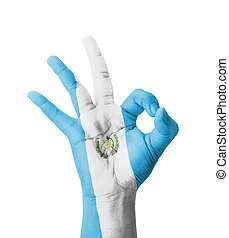Hand making Ok sign, Guatemala flag painted as symbol of...