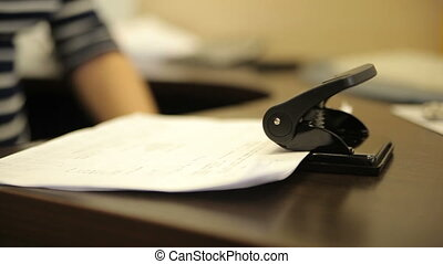 Hole punch for binding documents