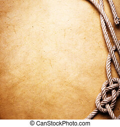 Old rope and knot on paper - An old rope tied in a knot on...