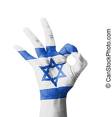 Hand making Ok sign, Israel flag painted as symbol of best...