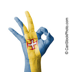 Hand making Ok sign, Madeira flag painted as symbol of best...