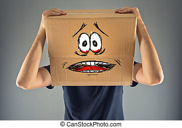 Man with cardboard box on his head and terrified look...