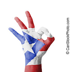 Hand making Ok sign, Puerto Rico flag painted as symbol of...