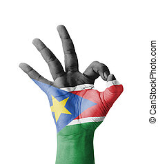 Hand making Ok sign, South Sudan flag painted as symbol of...
