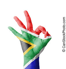 Hand making Ok sign, South Africa flag painted as symbol of...