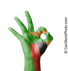 Hand making Ok sign, Zambia flag painted as symbol of best...