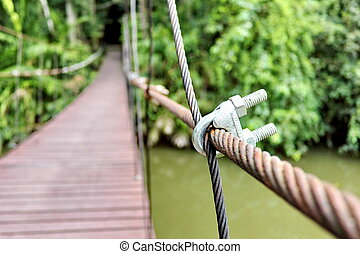 Rope bridge - Pinned with wooden rope bridge across the...