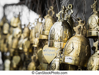 many of holy bell are hanging in a place of worship