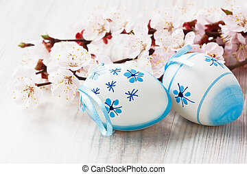 Easter egg decoration with apricot flower on wooden...