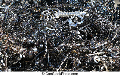 chips and curls of ferrous metal into landfill for recycling...