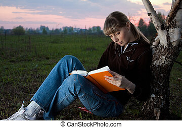 girl reading the book - girl reading book and sitting...