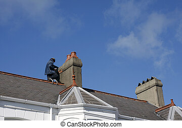 Workman repairing a chimney stack on a roof