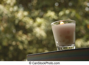 candle on book  with blurred background