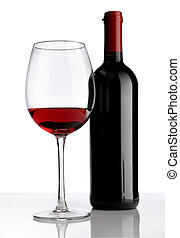 glass with red wine bottle on white